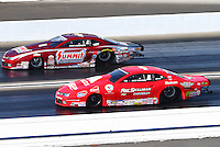 Feb 13, 2016; Pomona, CA, USA; NHRA pro stock driver Greg Anderson (far) against Drew Skillman during qualifying for the Winternationals at Auto Club Raceway at Pomona. Mandatory Credit: Mark J. Rebilas-USA TODAY Sports
