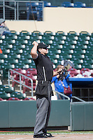 Home plate umpire Ryan Goodman tosses the game ball onto the field of the Omaha Storm Chasers before the game against the Memphis Redbirds in Pacific Coast League action at Werner Park on April 22, 2015 in Papillion, Nebraska.  (Stephen Smith/Four Seam Images)