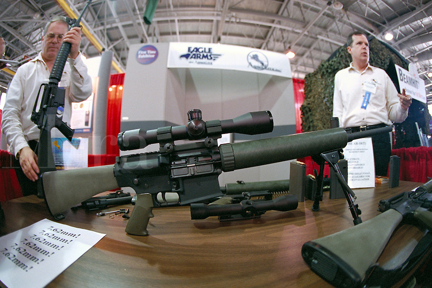 """Small arms at the """"""""Modern Marine"""""""" military arms trade show at Quantico Marine Corps Base, Virginia. Arms salesmen. Quantico Virginia."""