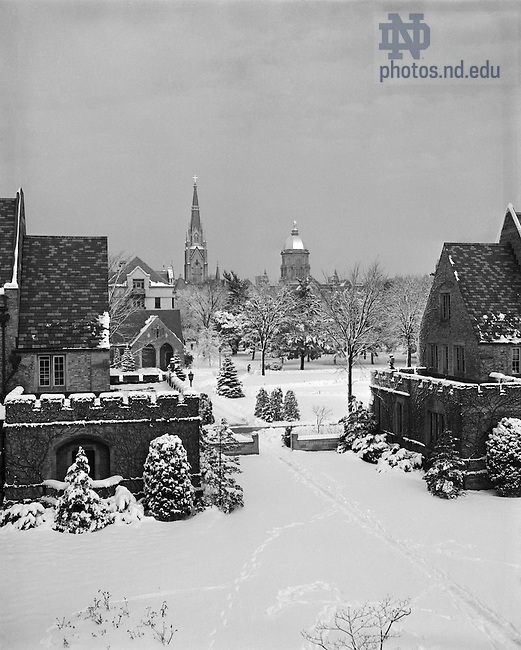 GPHR 45/1294:  View of the Alumni and Dillon Halls courtyard in winter with snow, December 1950.  In the background are the Knights of Columbus Council Hall, Walsh Hall, Basilica of the Sacred Heart, and Main Building.  Image from the University Archives.