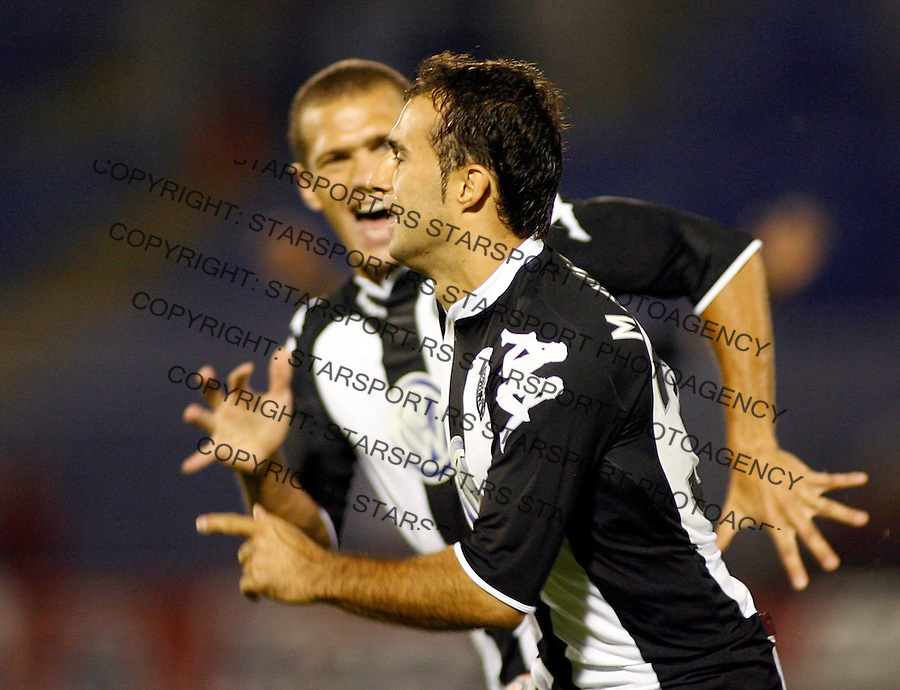 Partizan Belgrade player Darko Maletic, right, celebrates with team mate Liliano Roberto Antonello Juca, after scoring against NK Zrinjski, Mostar, Bosnia and Herzegovina, during UEFA Cup, first qualifying round, second leg, soccer match in Belgrade, Serbia, Thursday, Aug. 2, 2007. (Srdjan Stevanovic/starsportphoto.com)