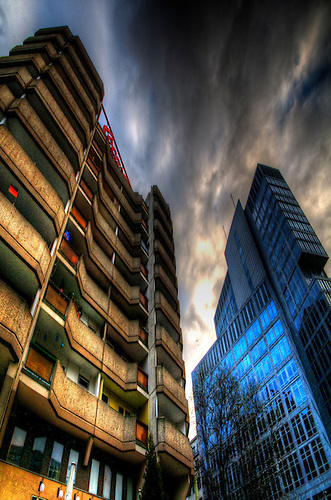 Surreal HDR of Berlin city, shot early evening..New buildings next to some old communist flats, in Berlin.