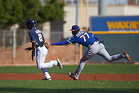 Texas Rangers Ti'Quan Forbes (77) tags out Ruddy Giron (2) during an instructional league game against the San Diego Padres on October 9, 2015 at the Surprise Stadium Training Complex in Surprise, Arizona.  (Mike Janes/Four Seam Images)