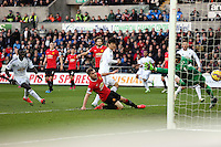 SWANSEA, WALES - FEBRUARY 21: Ki Sung Yueng of Swansea (C) scores his opening goal during the Barclays Premier League match between Swansea City and Manchester United at Liberty Stadium on February 21, 2015 in Swansea, Wales.