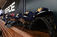 Montgomery Biscuits hats, gloves, sunglasses on the top of the dugout bench during a game against the Mississippi Braves on April 22, 2014 at Riverwalk Stadium in Montgomery, Alabama.  Mississippi defeated Montgomery 6-2.  (Mike Janes/Four Seam Images)