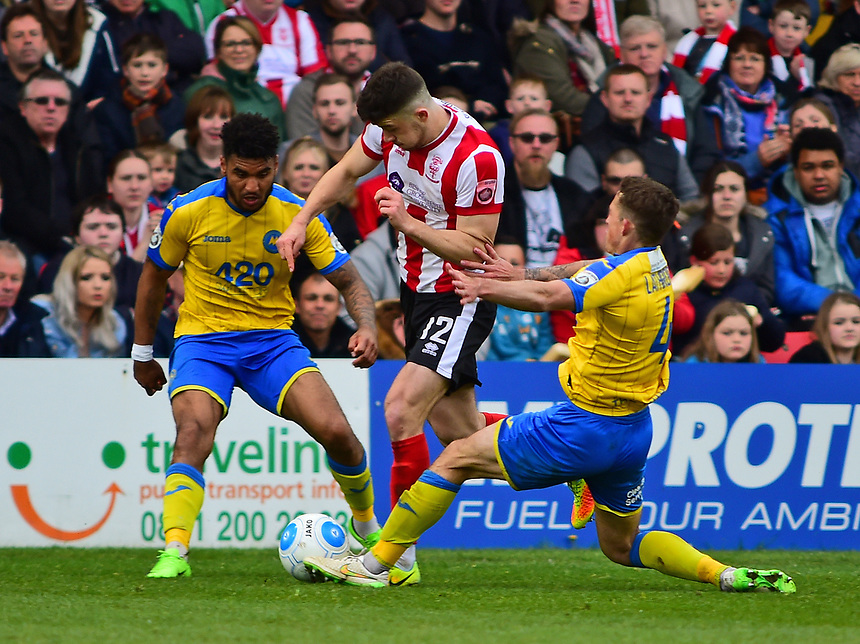 Lincoln City's Sean Long vies for possession with Torquay United's Damon Lathrope<br /> <br /> Photographer Andrew Vaughan/CameraSport<br /> <br /> Vanarama National League - Lincoln City v Chester - Tuesday 11th April 2017 - Sincil Bank - Lincoln<br /> <br /> World Copyright &copy; 2017 CameraSport. All rights reserved. 43 Linden Ave. Countesthorpe. Leicester. England. LE8 5PG - Tel: +44 (0) 116 277 4147 - admin@camerasport.com - www.camerasport.com
