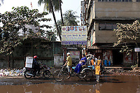 Pedestrians, bikes and motorbikes mix on a flooded street in Kolkata.<br /> <br /> To license this image, please contact the National Geographic Creative Collection:<br /> <br /> Image ID: 1925759 <br />  <br /> Email: natgeocreative@ngs.org<br /> <br /> Telephone: 202 857 7537 / Toll Free 800 434 2244<br /> <br /> National Geographic Creative<br /> 1145 17th St NW, Washington DC 20036