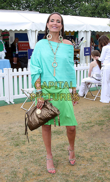 SOPHIE ANDERTON .Polo In The Park at the Hurlingham Club, London, England, UK,.June 5th 2009.full length top green skirt clutch bag brown sandals off the shoulder shoulders blue turquoise hoop earrings necklace jewellery gold links chunky .CAP/ROS.©Steve Ross/Capital Pictures