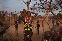 Pre Wedding celebration in Korcho Village.  The entire village including children were drunk on sorghum.  Some of the sorghum was left over from their farms but some was sorghum from USAID.  Groom is more than 45... looks 60 and the girl is maybe 25 and she has a boyfriend and a baby from that boyfriend who she intends to keep.  The groom knows about the boyfriend and does not care.  This is his second wife.  The first wife is with him in some of the photos...Contacts:..Lale Biwa.lalebiwa@yahoo.com
