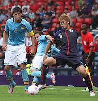 Men's Olympic Football match Spain v Japan on 26.7.12...Jordi Alba of Spain and Hiroki Sakai of Japan, during the Spain v Japan Men's Olympic Football match at Hampden Park, Glasgow.............