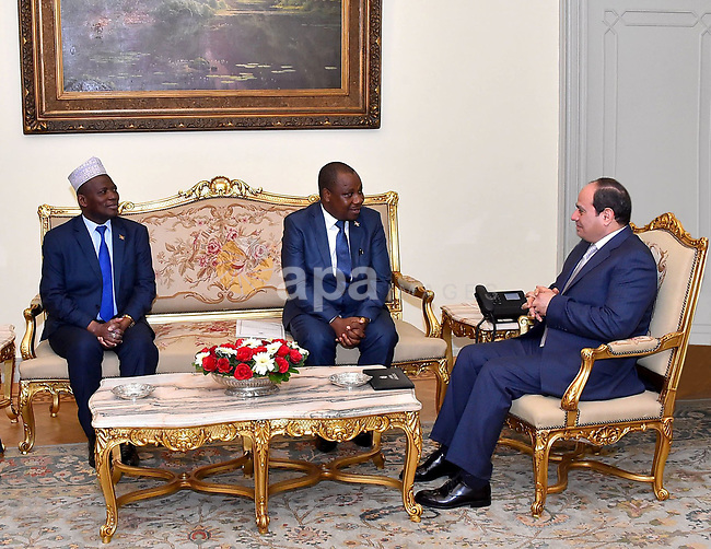 A handout picture released by the Egyptian Presidency on February 4, 2019 shows Egyptian President Abdel Fattah al-Sisi (R) meeting with Minister of Foreign Affairs of Burundi, Ezechiel Nibigira, at the presidential palace in the Egyptian capital Cairo. Photo by Egyptian President Office
