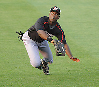 Kannapolis Intimidators right fielder Kenny Gilbert (26) dives but misses a fly ball during a game against the Greenville Drive on Spartanburg Night, Wednesday, May 25, 2011, at Fluor Field at the West End in Greenville, S.C. Photo by Tom Priddy / Four Seam Images