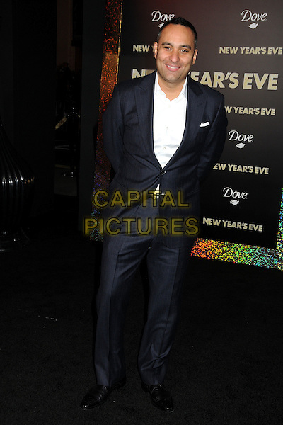 "Russell Peters.The World Premiere of ""New Year's Eve' held at The Grauman's Chinese Theatre in Hollywood, California, USA..December 5th, 2011.full length black suit white shirt.CAP/ADM/BP.©Byron Purvis/AdMedia/Capital Pictures."
