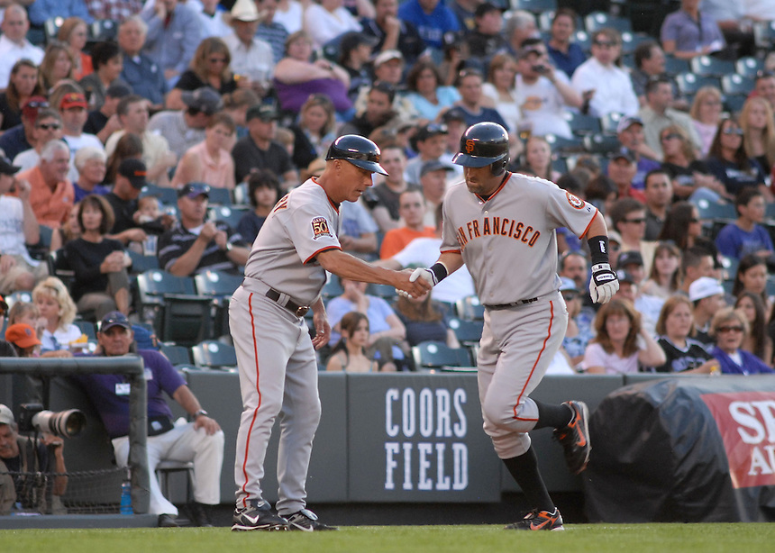 20 May 2008: Giants 3rd baseman Rich Aurilia is congratulated by 3rd base coach Tim Flannery during a regular season game between the San Francisco Giants and the Colorado Rockies at Coors Field in Denver, Colorado. The Giants beat the Rockies 6-5. *****For editorial use only*****