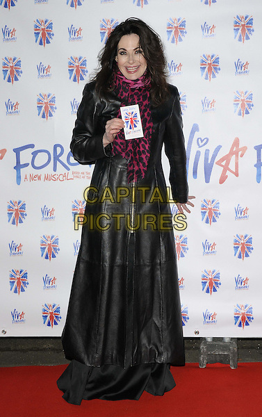 Sally Dexter.The 'Viva Forever!' press night afterparty, Supernova, Embankment Gardens, London, England..December 11th, 2012.full length black long leather coat jacket dress pink scarf leopard print smiling .CAP/CAN.©Can Nguyen/Capital Pictures.