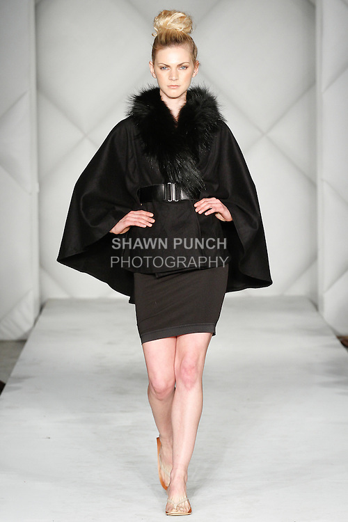 """Model walks runway in an outfit from the Marita Huurinainen Fall 2014 """"Wild by Marita Huurinainen"""" collection, during Fashion Week Brooklyn Fall Winter 2014, day two at Industry City, on March 16, 2014."""