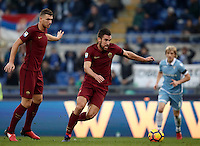 Calcio, Serie A: Lazio vs Roma. Roma, stadio Olimpico, 4 dicembre 2016.<br /> Roma&rsquo;s Kevin Strootman, right, flanked by his teammate Edin Dzeko, prepares to kick to score during the Italian Serie A football match between Lazio and Rome at Rome's Olympic stadium, 4 December 2016. Roma won 2-0.<br /> UPDATE IMAGES PRESS/Isabella Bonotto