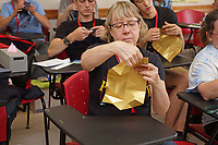 New York, NY, USA - June 24-25, 2017: OrigamiUSA 2017 Convention at St. John's University, Queens, New York, USA. The Challenge: Mark Bolitho teaches  his model Icosahedron. The model looks simple but requires a talented hand and a bit of luck to complete. Kathy Singer, Pennsylvania, struggled with this one until finally she put it together. Later she completed it again.