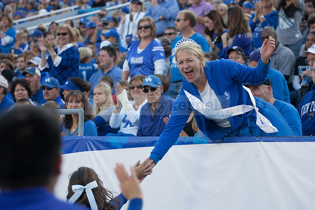 """Miss Big Ass Fan"" high fives members of the UK cheerleading team during the first half of the Kentucky Wildcats game against the Mississippi State Bulldogs at Commonwealth Stadium on Saturday, October 25, 2014 in Lexington, Ky. Mississippi leads Kentucky 17-10. Photo by Adam Pennavaria 