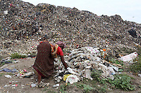 A woman collects and sorts through garbage at the Dhapa landfill in the west of Kolkata.<br /> <br /> To license this image, please contact the National Geographic Creative Collection:<br /> <br /> Image ID: 1925734 <br />  <br /> Email: natgeocreative@ngs.org<br /> <br /> Telephone: 202 857 7537 / Toll Free 800 434 2244<br /> <br /> National Geographic Creative<br /> 1145 17th St NW, Washington DC 20036