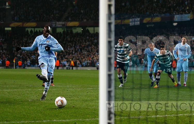 Manchester City's Mario Balotelli (L) scores a goal from the penalty spot..UEFA Europa League match between Manchester City v Sporting Lisbon at the Etihad Stadium, Manchester on the 15th March 2012..Sportimage +44 7980659747.picturedesk@sportimage.co.uk.http://www.sportimage.co.uk/.