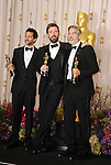 HOLLYWOOD, CA - FEBRUARY 24: Grant Heslov , Ben Affleck and George Clooney pose in the press room the 85th Annual Academy Awards at Dolby Theatre on February 24, 2013 in Hollywood, California.