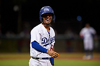 AZL Dodgers Mota Juan Zabala (60) laughs as he walks to first base after being hit in the head by a pitch during an Arizona League game against the AZL Rangers at Camelback Ranch on June 18, 2019 in Glendale, Arizona. AZL Dodgers Mota defeated AZL Rangers 13-4. (Zachary Lucy/Four Seam Images)