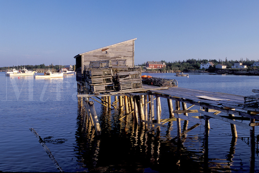 Maine, Corea, ME, Lobster traps on a dock in the scenic harbor of the fishing village of Corea.