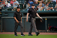 Umpires Rene Gallegos (L) and Mitch Leikam (R) before a South Atlantic League game between the Greensboro Grasshoppers and Delmarva Shorebirds on August 21, 2019 at Arthur W. Perdue Stadium in Salisbury, Maryland.  Delmarva defeated Greensboro 1-0.  (Mike Janes/Four Seam Images)
