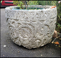 Early medieval font found in garden pond.