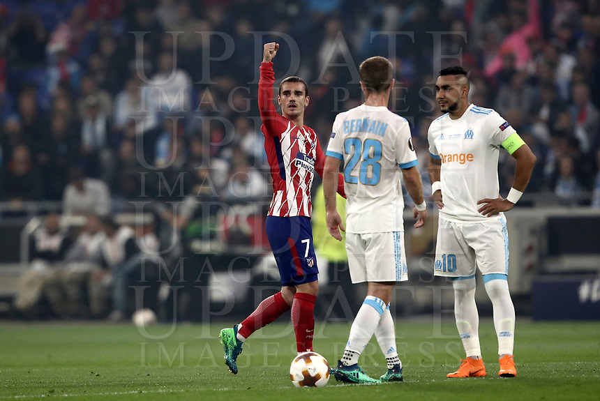 Club Atletico de Madrid's Antoine Griezmann, left, celebrates past Olympique de Marseille's Valere Germain, center, and Dimitri Payet, after scoring his first goal during the UEFA Europa League final football match between Olympique de Marseille and Club Atletico de Madrid at the Groupama Stadium in Decines-Charpieu, near Lyon, France, May 16, 2018.<br /> UPDATE IMAGES PRESS/Isabella Bonotto