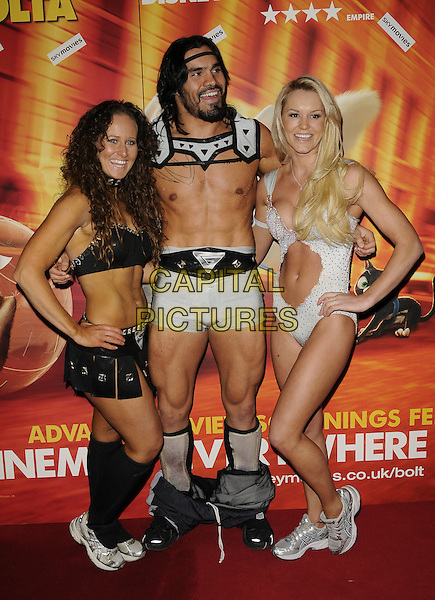 "CYCLONE, WARRIOR & SIREN - GLADIATORS.The ""Bolt"" VIP screening, Cineworld cinemas, Haymarket, London, England..February 1st, 2009.full length black silver costume belly stomach midriff skirt shorts spandex hand on hip cleavage .CAP/CAN.©Can Nguyen/Capital Pictures."