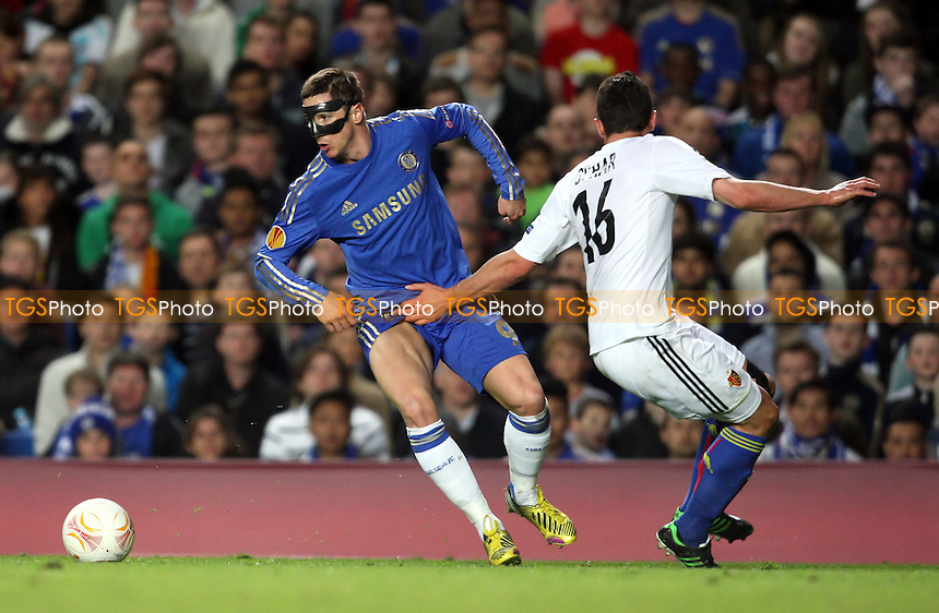 Fabian Schar of Basel gets hold of Fernando Torres of Chelsea - Chelsea vs Basel, UEFA Europa League Semi-Final 2nd Leg at Stamford Bridge, Chelsea - 02/05/13 - MANDATORY CREDIT: Rob Newell/TGSPHOTO - Self billing applies where appropriate - 0845 094 6026 - contact@tgsphoto.co.uk - NO UNPAID USE.