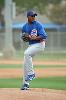 Alberto Cabrera #76 of the Chicago Cubs participates in pitchers fielding practice during spring training workouts at the Cubs complex on February 19, 2011  in Mesa, Arizona. .Photo by Bill Mitchell / Four Seam Images.