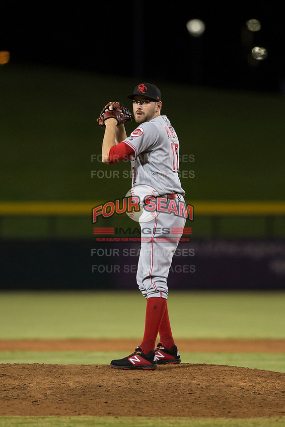 Scottsdale Scorpions relief pitcher Alex Powers (17), of the Cincinnati Reds organization, gets ready to deliver a pitch during an Arizona Fall League game against the Mesa Solar Sox at Sloan Park on October 10, 2018 in Mesa, Arizona. Scottsdale defeated Mesa 10-3. (Zachary Lucy/Four Seam Images)