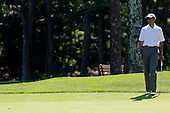 United States President Barack Obama watches his putt on the first green during a round of golf at the Farm Neck Golf Club in Oak Bluffs, Massachusetts, U.S., on Saturday, August 9, 2014.  The President, who arrived on the island today, is vacationing  for two weeks. <br /> Credit: Matthew Healey / Pool via CNP