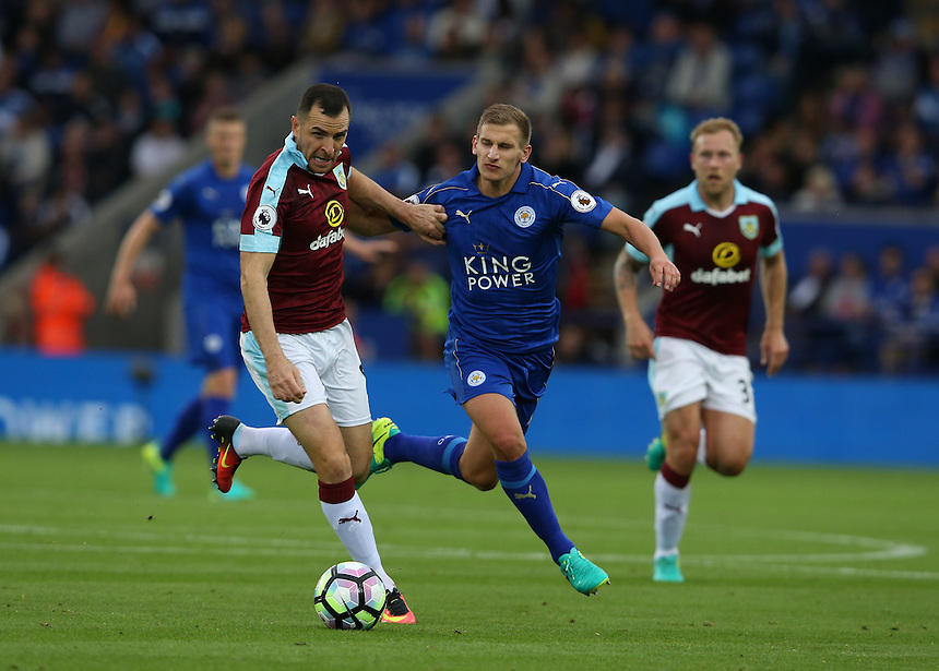 Burnley's Dean Marney shields the ball from Leicester City's Marc Albrighton<br /> <br /> Photographer Stephen White/CameraSport<br /> <br /> The Premier League - Leicester City v Burnley - Saturday 17th September 2016 - King Power Stadium - Leicester <br /> <br /> World Copyright &copy; 2016 CameraSport. All rights reserved. 43 Linden Ave. Countesthorpe. Leicester. England. LE8 5PG - Tel: +44 (0) 116 277 4147 - admin@camerasport.com - www.camerasport.com