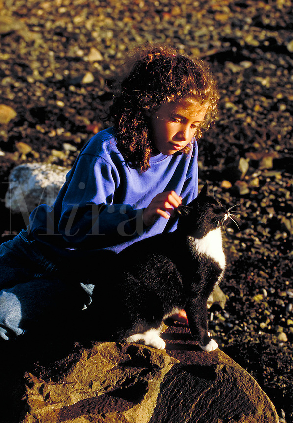 Girl petting a cat