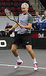 John McEnroe (USA), defeats Todd Martin (USA) 6-3