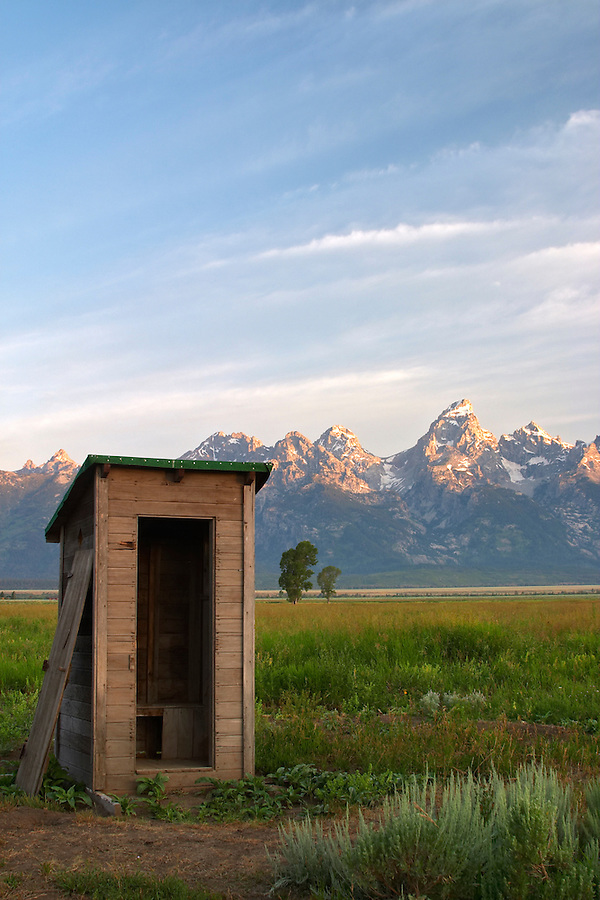 Old outhouse in meadow below the Grand Teton in early morning, Grand Teton National Park, Teton County, Wyoming, USA