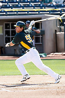 Hideki Matsui #55 of the Oakland Athletics bats in an intrasquad game during spring training workouts at Phoenix Municipal Stadium on February 24, 2011  in Phoenix, Arizona. .Photo by:  Bill Mitchell/Four Seam Images.