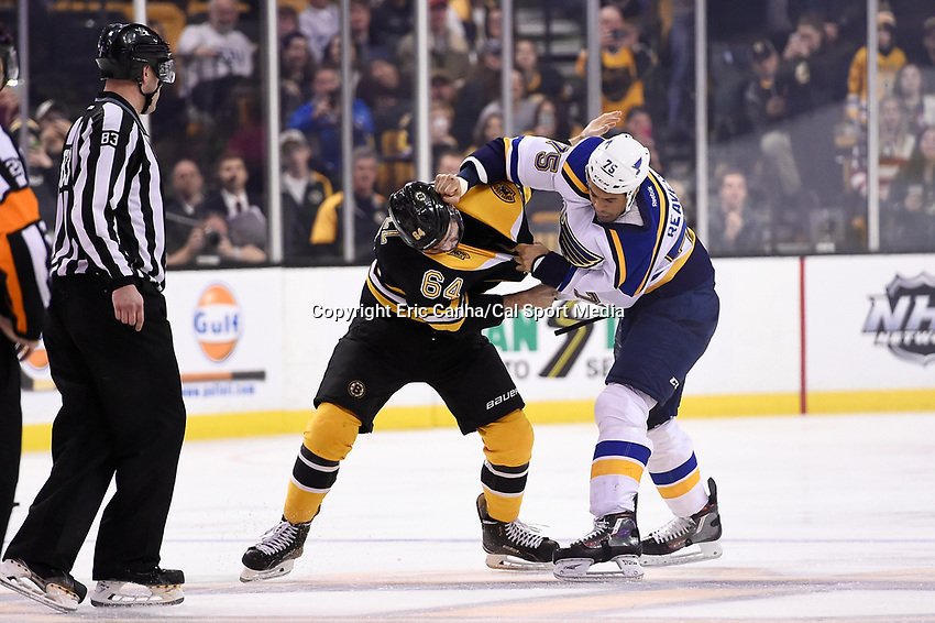 Tuesday, December 22, 2015: Boston Bruins right wing Tyler Randell (64) and St. Louis Blues right wing Ryan Reaves (75) fight at center ice during the National Hockey League game between the St. Louis Blues and the Boston Bruins held at TD Garden, in Boston, Massachusetts. The blues beat the Bruins 2-0 in regulation time. Eric Canha/CSM