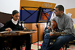 "FOR FAOIROUZ SONG ""THE FLOWER OF THE CITIES"" - A Palestinian girl plays the Kanoun  and her teacher the Oud during a lesson in the Edward Said National Conservatory of Music in East Jerusalem. Photo by Quique Kierszenbaum."