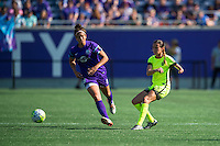 Orlando, Florida - Sunday, May 8, 2016: Seattle Reign FC defender Carson Pickett (16) makes a pass while pressured by Orlando Pride forward Sarah Hagen (8) during a National Women's Soccer League match between Orlando Pride and Seattle Reign FC at Camping World Stadium.