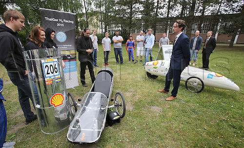 26.05.2016. London, England.  The two teams from Mecklenburg-Western Pomerania participating in the Shell Eco-marathon in London present themselves to State Minister of Education Mathias Brodkorb in Rostock, 26 May 2016. To the left is the team from the Fachhochschule Stralsund, to the right is the one from Rostock University. The goal of the Shell Eco-marathon is to travel as far as possible with a liter of fuel or the respective energy equivalent. 300 teams from more than 28 countries are taking part this year.