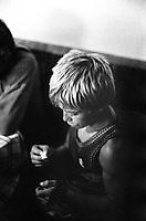 ROMANIA, Delta of Danube, Mila 23, April 2000..A child is playing with matches in the bar of Mila 23..ROUMANIE, Delta du Danube, Mila 23, Avril 2000..Un enfant joue avec des allumettes dans le bar de Mila 23..© Bruno Cogez