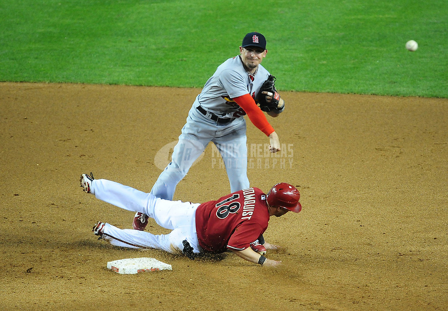 May 9, 2012; Phoenix, AZ, USA; St. Louis Cardinals second baseman Tyler Greene throws to first base to complete the double play after forcing out Arizona Diamondbacks base runner Willie Bloomquist in the fifth inning at Chase Field. Mandatory Credit: Mark J. Rebilas-