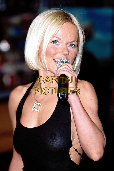 """GERI HALLIWELL..Promoting Her New Album """"Scream if You Wanna Go Faster"""" At Virgin Megastore in Picadilly..halter neck, necklace, boob tape unstuck, see through top, see thru, bleach blonde bob, headshot, portrait, microphone..www.capitalpictures.com..sales@capitalpictures.com..©Capital Pictures.."""