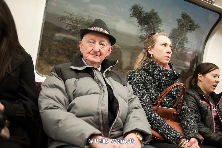 Passengers on a London Underground train.