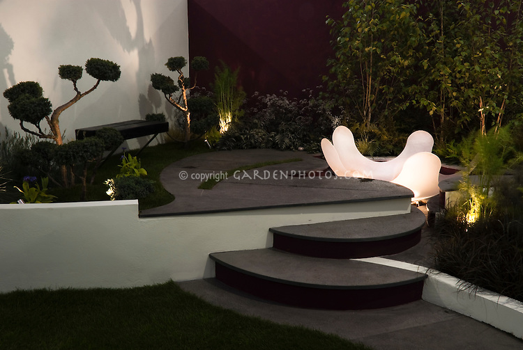 Tiered Patio, garden bench, wall, modern plantings, lights for evening enjoyment